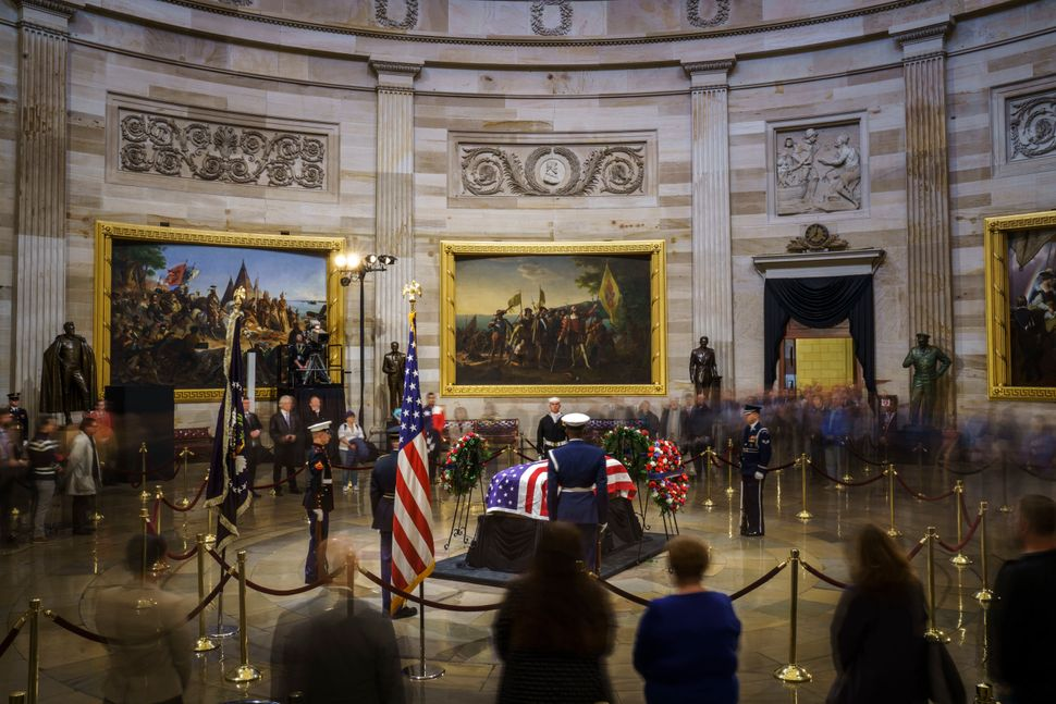 Members of the public file through the Capitol Rotunda to view the casket.