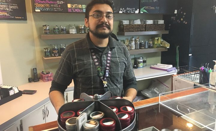 Budtender Rico Vasquez stands behind a counter displaying recreational pot products for sale at Smokey's: A 4:20 House in Gar