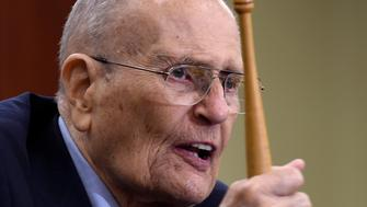 Former Michigan Rep. John Dingell holds up the gavel he used 50 years ago when Medicare legislation was passed, as he speaks at an event marking the 50th Anniversary of Medicare and Medicaid, Wednesday, July 29, 2015, on Capitol Hill in Washington. (AP Photo/Susan Walsh)