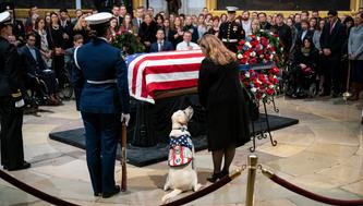 WASHINGTON, DC - DECEMBER 4:  Sully, a yellow Labrador service dog for former President George H. W. Bush, sits near the casket of the late former President George H.W. Bush as he lies in state at the U.S. Capitol, December 4, 2018 in Washington, DC. A WWII combat veteran, Bush served as a member of Congress from Texas, ambassador to the United Nations, director of the CIA, vice president and 41st president of the United States. Bush will lie in state in the U.S. Capitol Rotunda until Wednesday morning. (Photo by Drew Angerer/Getty Images)