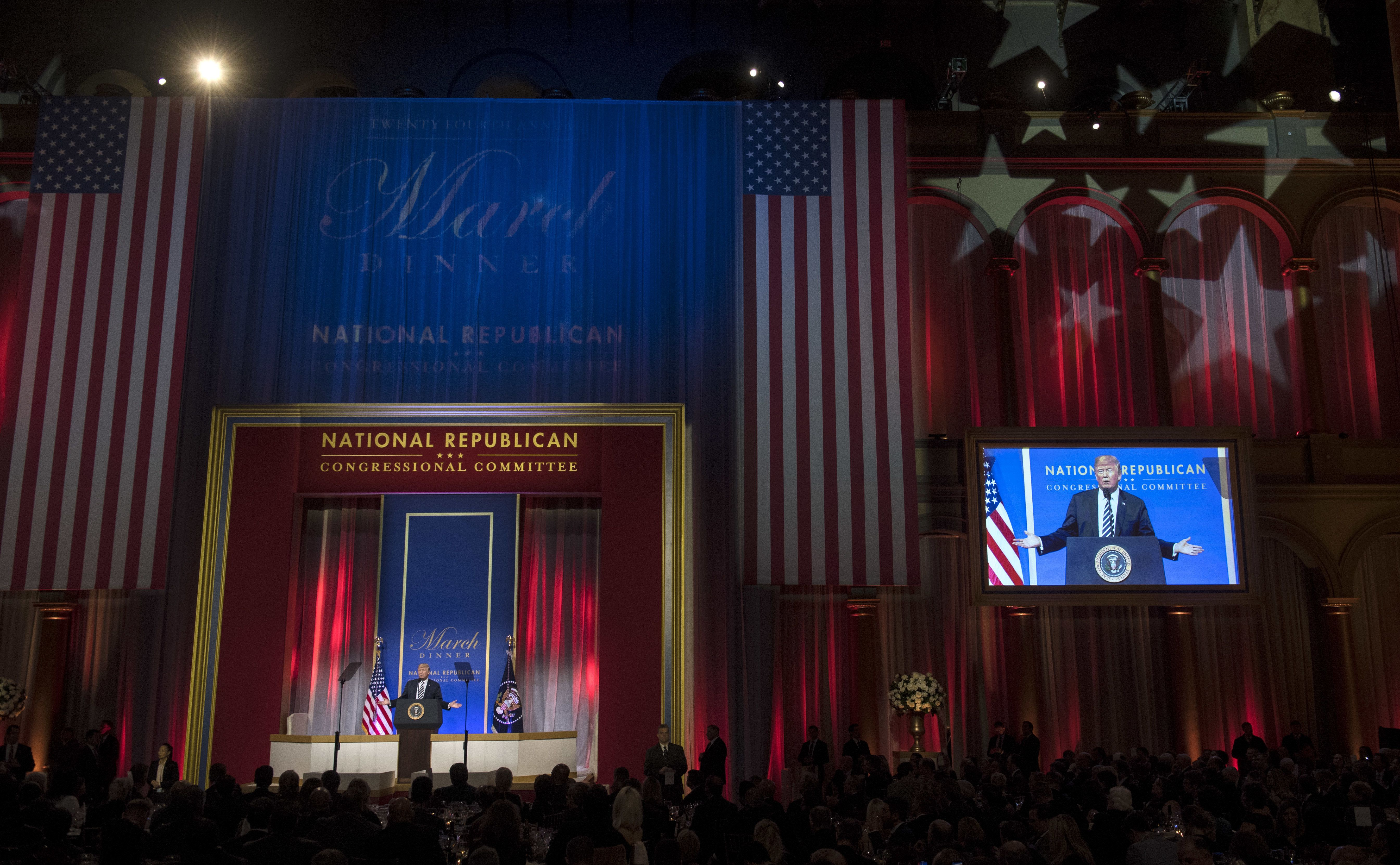 U.S. President Donald Trump delivers a speech at the National Republican Congressional Committee (NRCC) annual March Dinner at the National Building Museum in Washington, D.C., on Tuesday, March 20, 2018. Republicans are privately alarmed that Trump may try to oust Mueller -- a move that would risk setting off a constitutional crisis -- but few have threatened specific consequences if the president does so. Photographer: Kevin Dietsch/Pool via Bloomberg