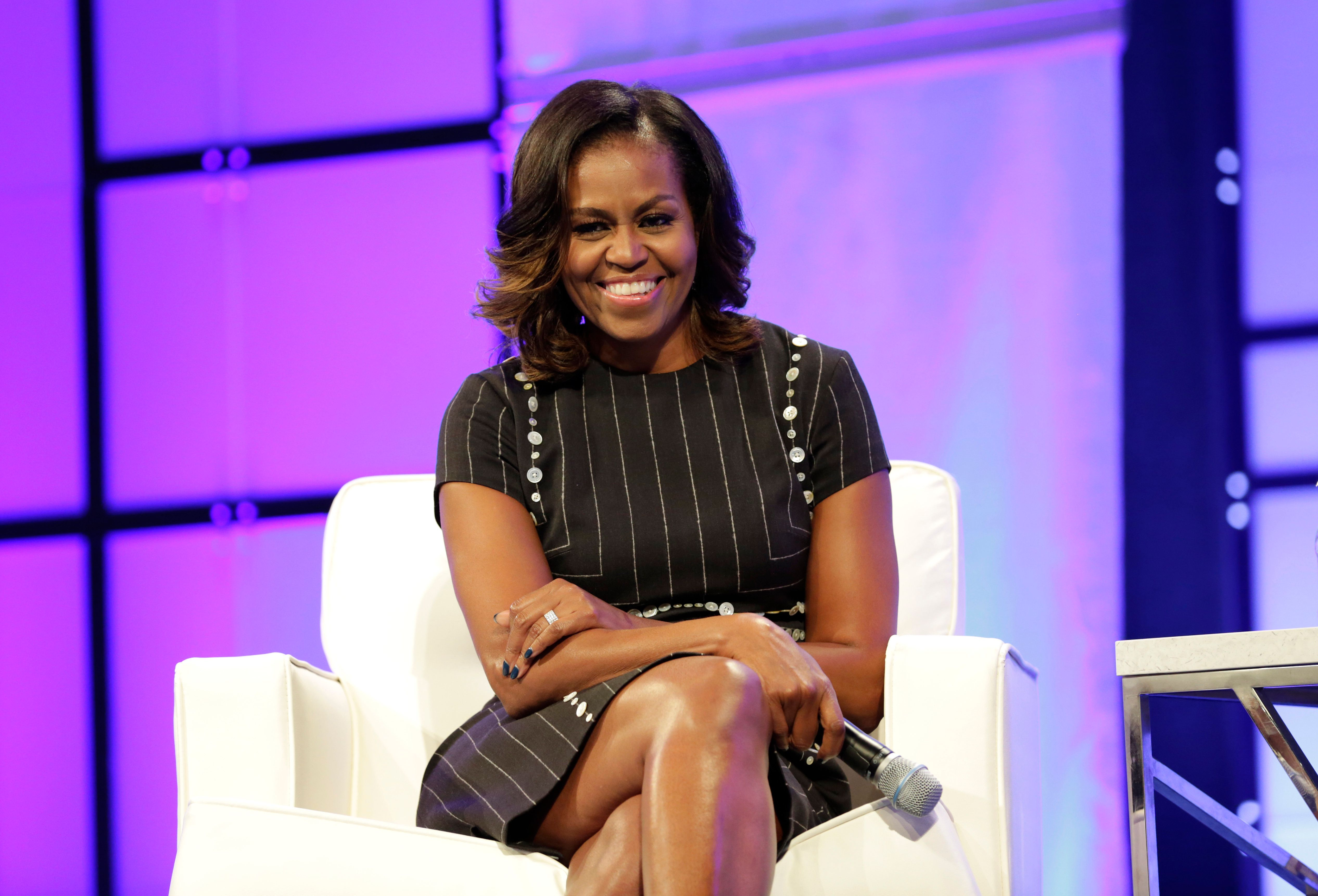 PHILADELPHIA, PA - OCTOBER 03:  Former First Lady of the United States Michelle Obama watches the surprise video message from her husband Former President of the United States Barack Obama during Pennsylvania Conference For Women 2017 at Pennsylvania Convention Center on October 3, 2017 in Philadelphia, Pennsylvania.  (Photo by Marla Aufmuth/Getty Images for Pennsylvania Conference for Women)