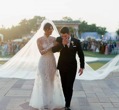 Priyanka Chopra Stuns In 75-Foot-Long Veil At Wedding To Teary Nick