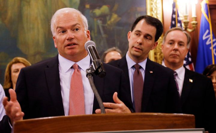 Wisconsin state Senate President Scott Fitzgerald (left), Gov. Scott Walker (center) and Assembly Speaker Robin Vos -- all Republicans -- have led an effort to rein in the powers of statewide offices that Democrats won from the GOP in November.