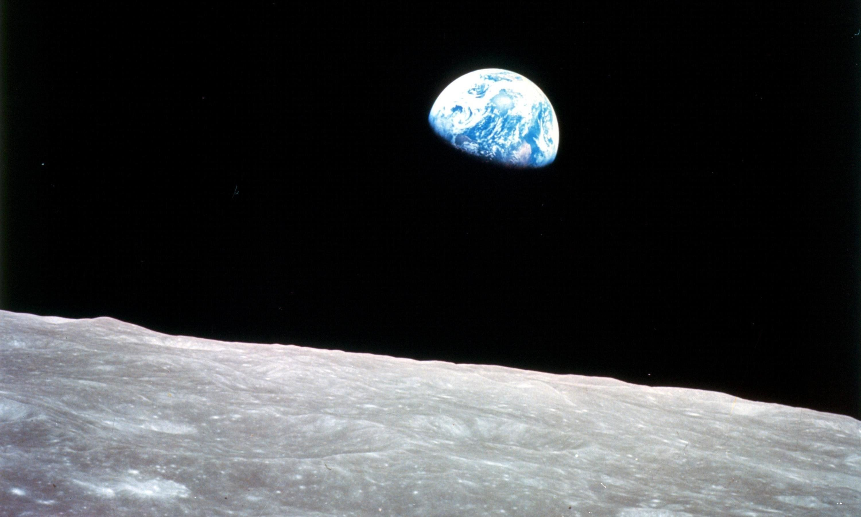 Earthrise over the moon, taken on Christmas Eve, 1968, from Apollo 8.
