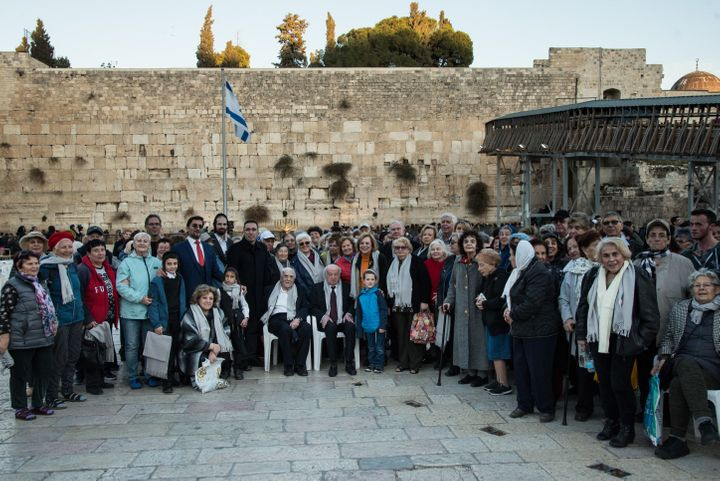 Claims Conference leaders and Holocaust survivors stand at Jerusalem's Western Wall before a menorah lighting.