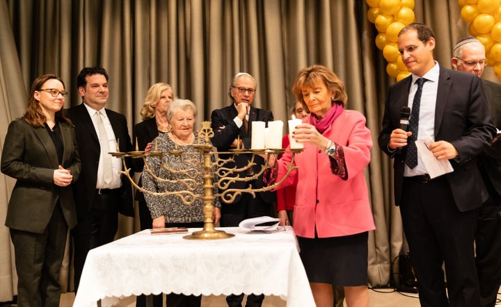 German politicians, Jewish leaders and Holocaust survivors light a menorah at a Jewish community center in Berlin.