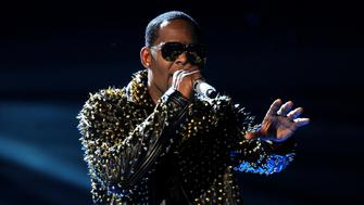 FILE - In this June 30, 2013, file photo, R. Kelly performs onstage at the BET Awards at the Nokia Theatre in Los Angeles. A woman filed a lawsuit Monday, May 21, 2018, in New York against R. Kelly, claiming the singer sexually assaulted her. He has long been the target of sexual misconduct allegations, which he has denied. (Photo by Frank Micelotta/Invision/AP, File)