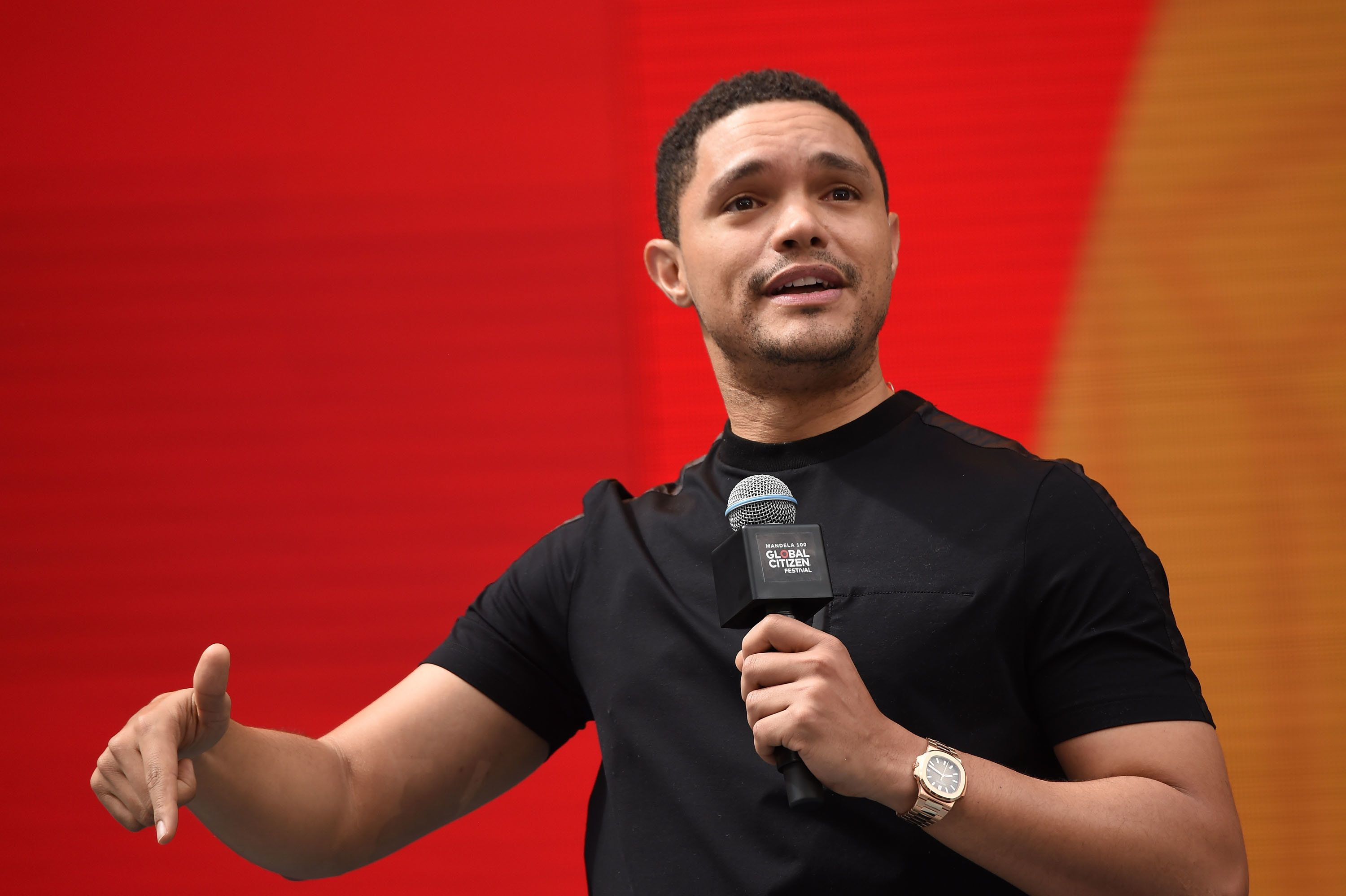 JOHANNESBURG, SOUTH AFRICA - DECEMBER 02:  Trevor Noah speaks on stage during the Global Citizen Festival: Mandela 100 at FNB Stadium on December 2, 2018 in Johannesburg, South Africa.  (Photo by Kevin Mazur/Getty Images for Global Citizen Festival: Mandela 100)