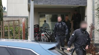 Policemen walk on December 5, 2018 in front of the residential building of the owner of an Italian Osteria restaurant in Pulheim near Cologne, western Germany, after the man, a main suspected, was arrested in an anti-mafia raid. - Around 90 people suspected of belonging to the notorious 'Ndrangheta mafia were rounded up in raids across several European and Latin American countries, Italian police said. The suspects are thought to be key members of the powerful organised crime syndicate based in southern Italy. They are accused of committing 'serious crimes' including activities linked to international drug trafficking. The vast anti-mafia operation was carried out by Italy's anti-mafia and anti-terrorism force in collaboration with German, Belgian and Dutch authorities. (Photo by Oliver Berg / dpa / AFP) / Germany OUT        (Photo credit should read OLIVER BERG/AFP/Getty Images)