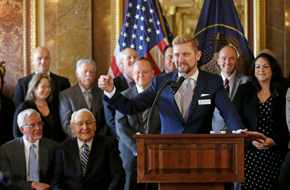Equality Utah Executive Director Troy Williams (right) speaks after Utah lawmakers introduced a landmark anti-discrimination