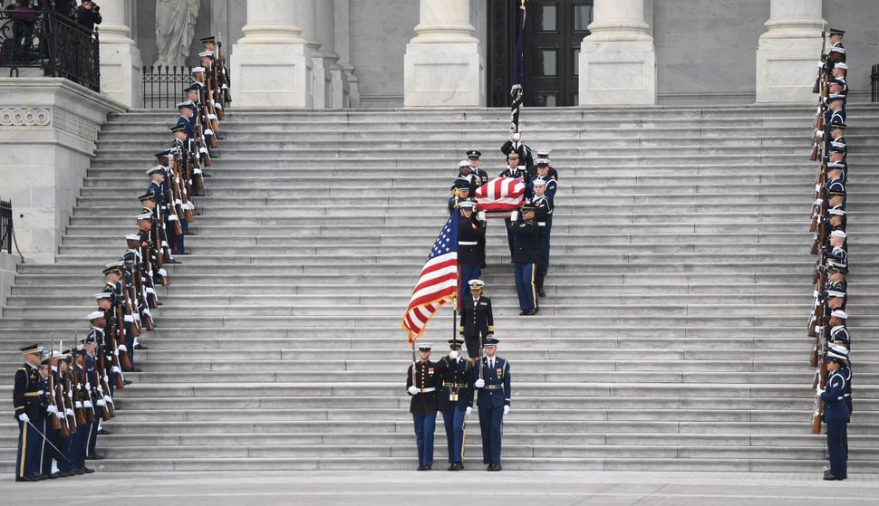 The casket departs the U.S. Capitol.