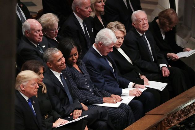 President Trump sits with former presidents Obama, Clinton and Carter at state funeral for...