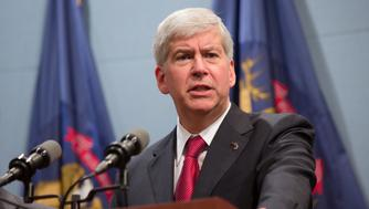 December 11, Lansing MI, Governor Rick Snyder of Michigan holds a press conference at the end of the day after passing the RIght-to Work bill into law despite thousands of union members turning out at the state capitol to protest. (Photo by Julie Dermansky/Corbis via Getty Images)