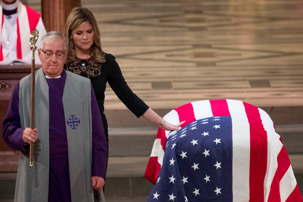 Jenna Bush Hager, the daughter of former President George Bush, touches the casket of former President George H.W. Bush after