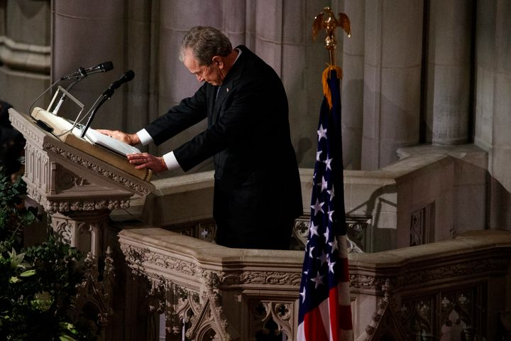 Former President George W. Bush fights back tears as he speaks during the state funeral for his father, former President Geor