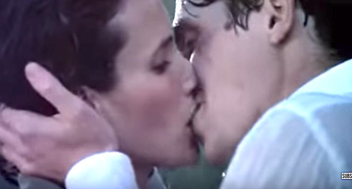 "Andie MacDowell's Carrie and Hugh Grant's Charles kiss in the rain in ""Four Weddings and a Funeral."""