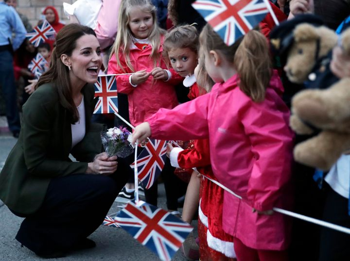 Saying hello to little royal fans with flags!
