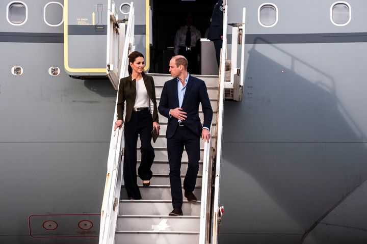 The Duke and Duchess of Cambridge descend from their airplane as they arrive at RAF Akrotiri to celebrate the upcoming Christ