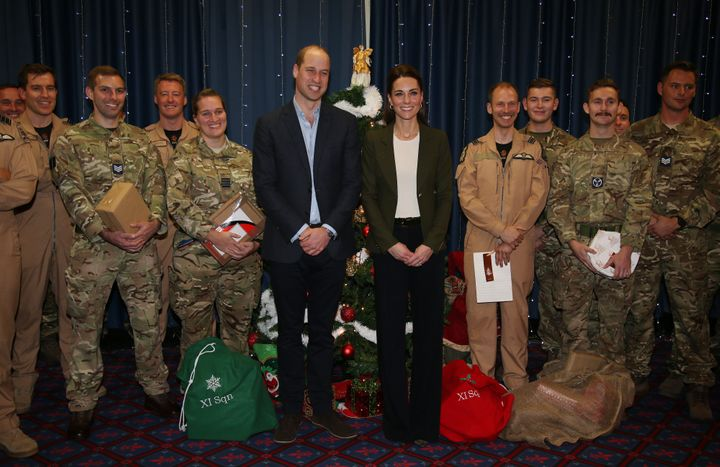 Prince William, Duke of Cambridge and Catherine, Duchess of Cambridge visit military personnel and hand out gifts.