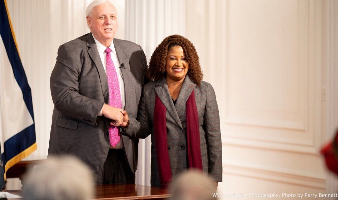 West Virginia Gov. Jim Justice (left) and Jill Upson pose.