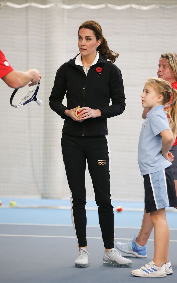 The Duchess of Cambridge takes part in a Tennis for Kids session during a visit at the Lawn Tennis Association at the Nationa