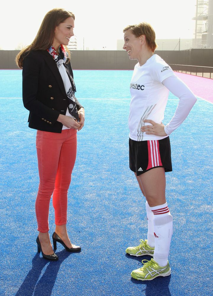 Women's Team GB hockey captain Kate Walsh and Catherine, Duchess of Cambridge chat in Olympic Park on March 15, 2012, in Lond
