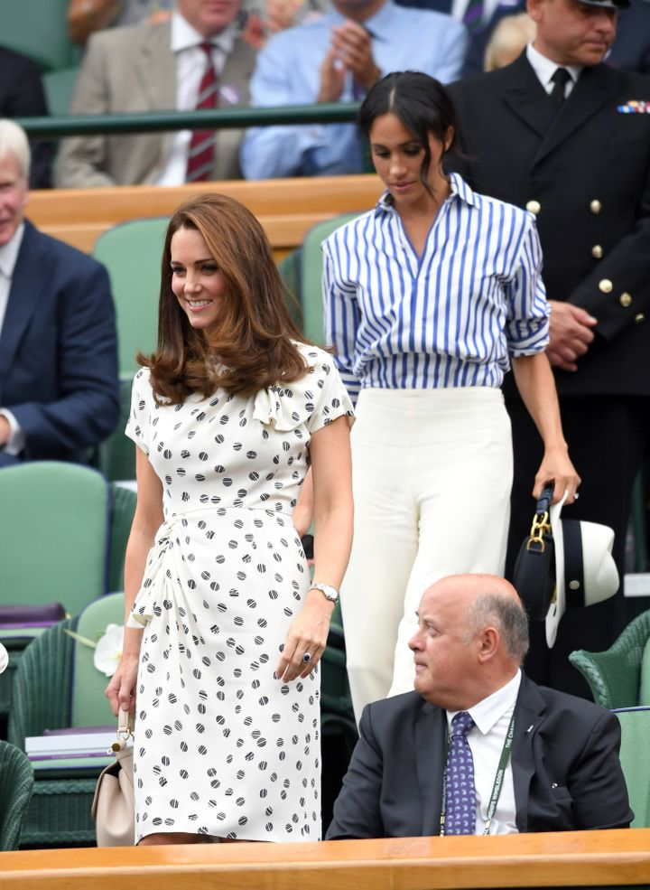 Catherine, Duchess of Cambridge and Meghan, Duchess of Sussex attend Day 12 of the Wimbledon Tennis Championships on July 14,
