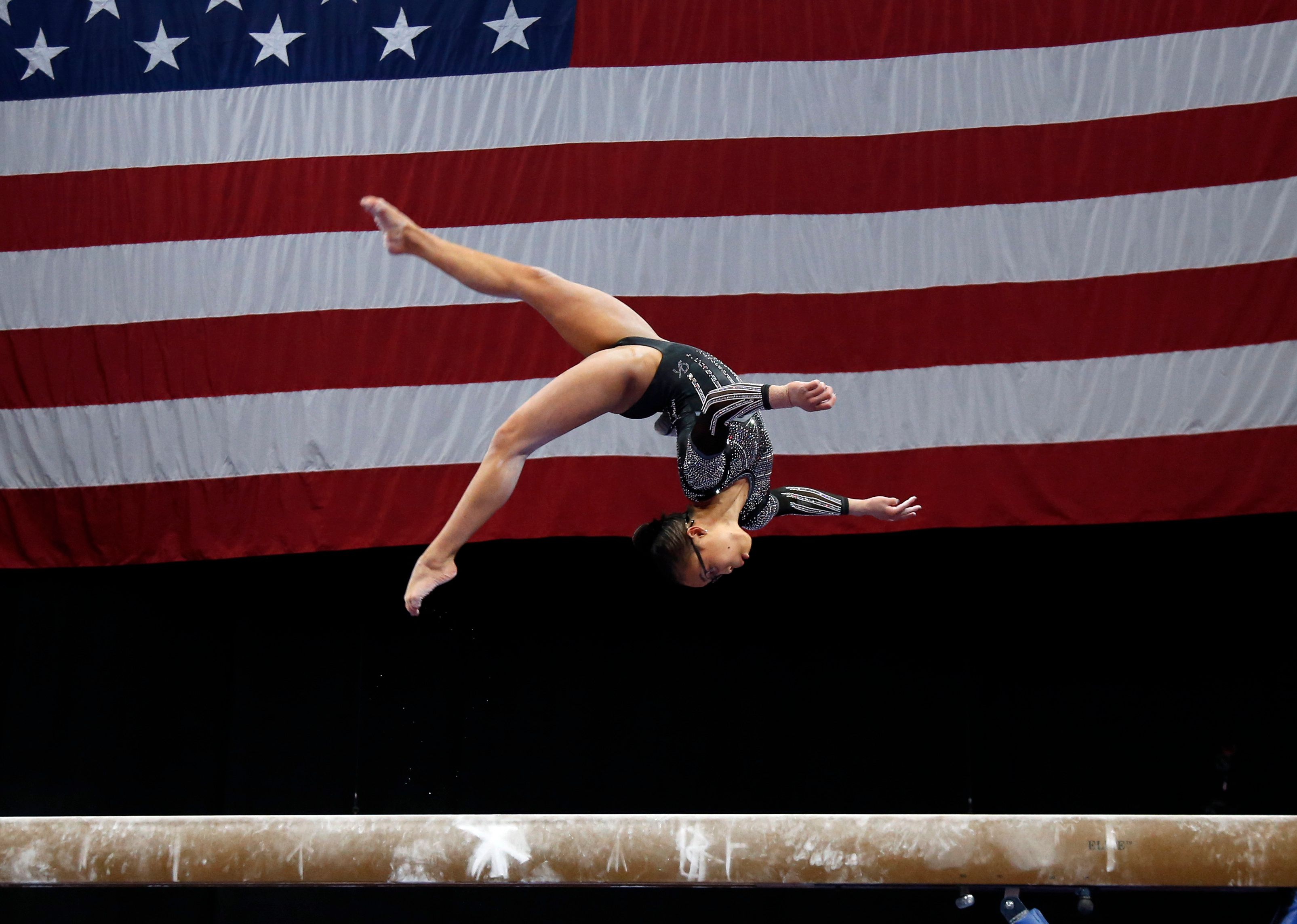 Morgan Hurd competes on the balance beam at the U.S. Gymnastics Championships, Sunday, Aug. 19, 2018, in Boston. (AP Photo/Elise Amendola)