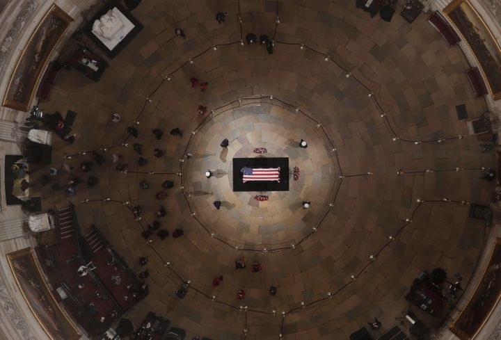 Members of the public are seen inside the Capitol Rotunda as former President George H.W. Bush lies in state on Wednesday ahead of his memorial service.
