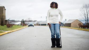 Debra Green, of Duquesne, poses for a portrait in the driveway of her apartment complex.