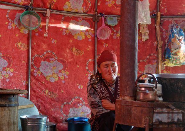 Bukeshova Urmatgul Kachkynovna inside her yurt in Kyrgyzstan. The daughter of a nomadic herder, she remembers...