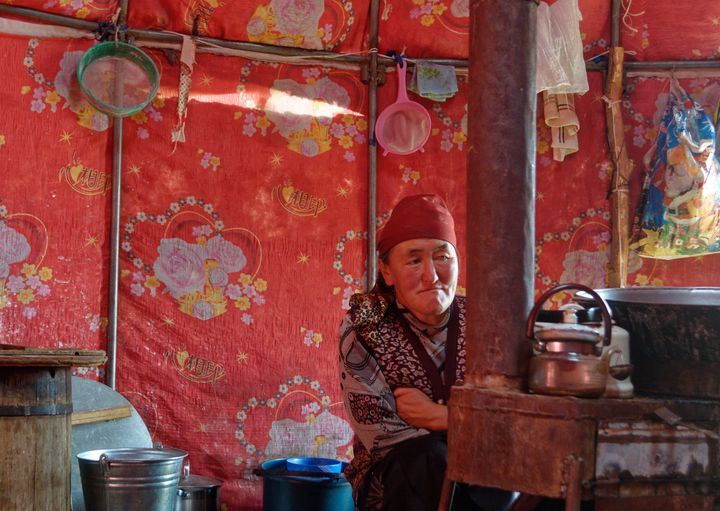 Bukeshova Urmatgul Kachkynovna inside her yurt in Kyrgyzstan. The daughter of a nomadic herder, she remembers traveling great