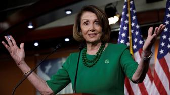 U.S. House Democratic Leader Nancy Pelosi (D-CA) gestures during a news conference on Capitol Hill in Washington, U.S., December 6, 2018. REUTERS/Yuri Gripas
