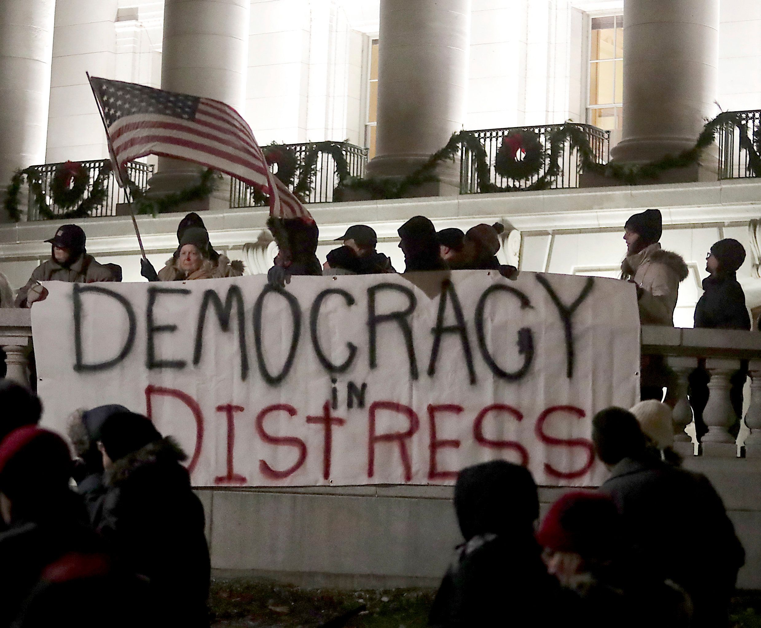 Protesters have gathered at the Wisconsin state capitol in recent days to protest a power grab aimed...