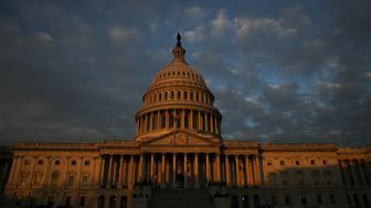WASHINGTON, DC - DECEMBER 5: Morning sunlight hits the Capitol dome before the departure of the flag-draped casket of the late former President George H.W. Bush at the U.S. Capitol, December 5, 2018 in Washington, DC. A WWII combat veteran, Bush served as a member of Congress from Texas, ambassador to the United Nations, director of the CIA, vice president and 41st president of the United States. (Photo by Drew Angerer/Getty Images)