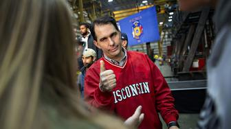 Scott Walker, governor of Wisconsin, gives a thumbs up during a campaign rally at Weldall Manufacturing Inc., in Waukesha, Wisconsin, U.S., on Monday, Nov. 5, 2018. The most expensive midterm campaign in U.S. history raced to a finish ahead of Tuesday's elections, as both sides braced for a possible split decision that would hand the House to Democrats and leave Republicans holding onto or expanding their Senate majority. Photographer: Daniel Acker/Bloomberg via Getty Images