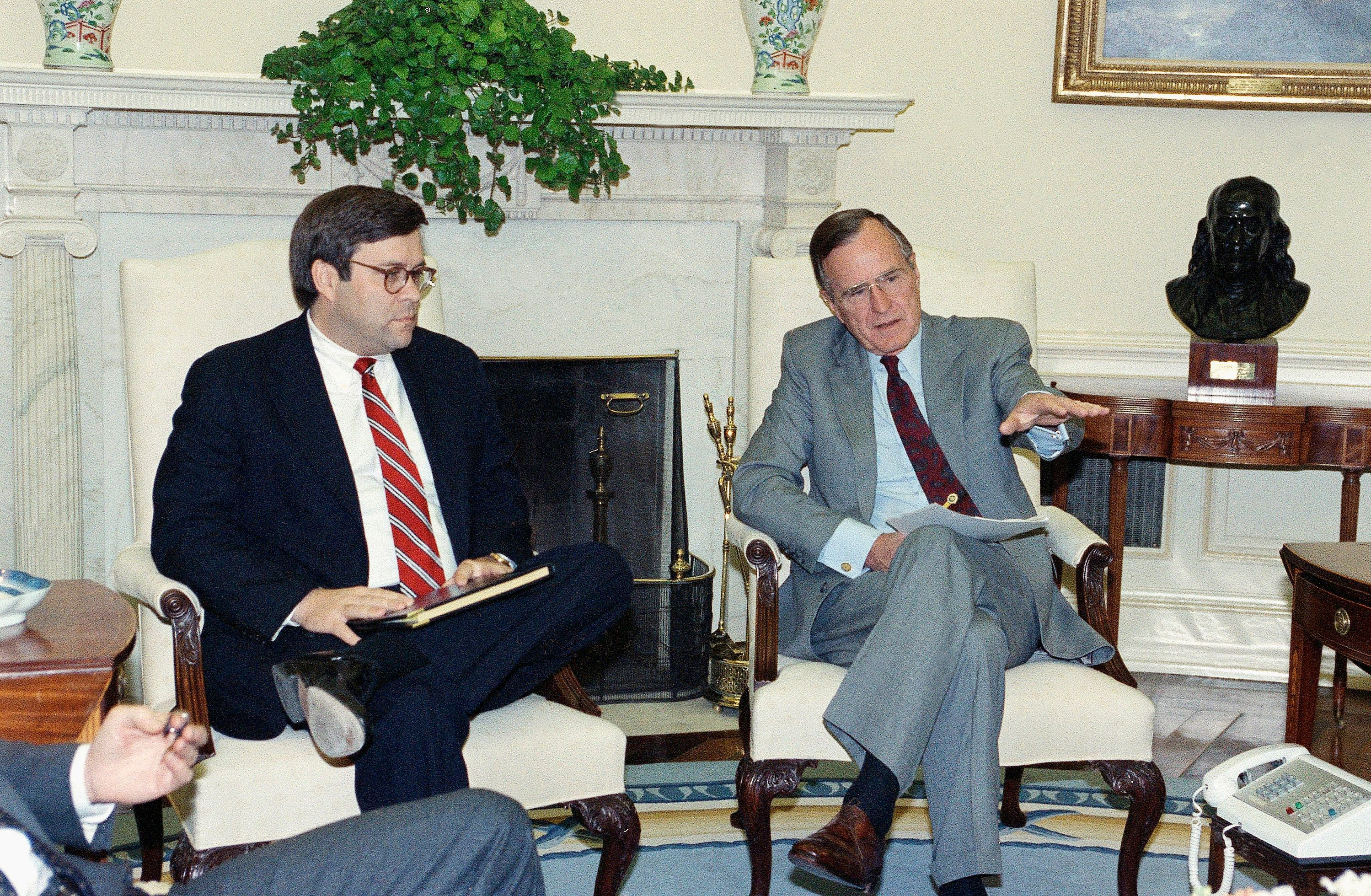 William Barr, left, is seen in 1992 with President George H.W. Bush when Barr was serving as U.S. attorney general.