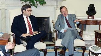 U.S. President George H. Bush gestures while talking to Attorney General William Barr in the Oval Office of the White House, Monday, May 4, 1992 in Washington. The President met with top domestic Cabinet officers to tackle long-range problems pushed to the forefront by last week's deadly riots in Los Angeles. (AP Photo/Marcy Nighswander)