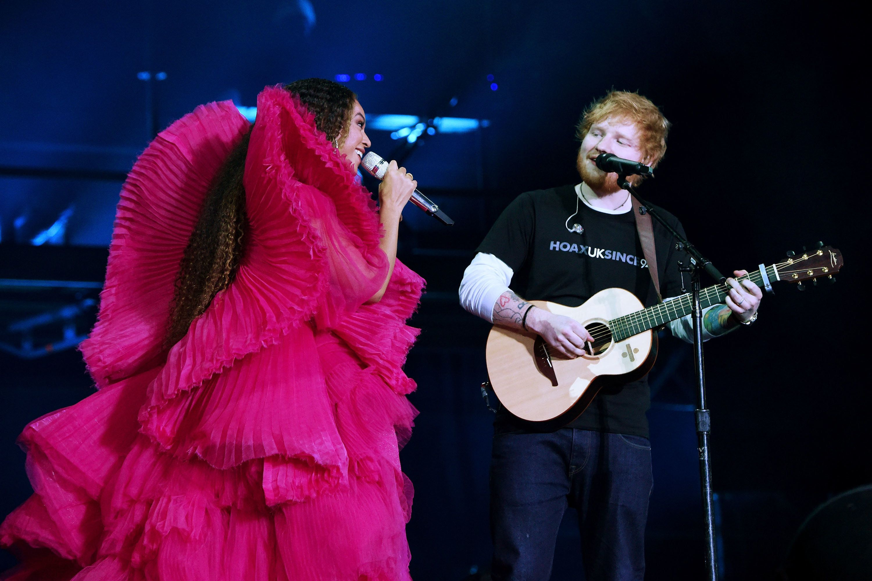 Beyoncé and Ed Sheeran perform during the Global Citizen Festival Sunday.