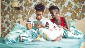 Young couple is browsing the internet on a tablet