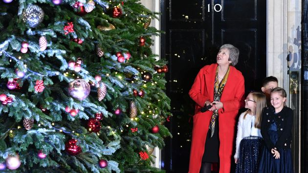 Theresa May will children turning on the Christmas lights in Downing Street
