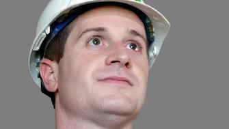 Dan McCready headshot, as Democratic nominee for Senate of North Carolina, graphic element on gray