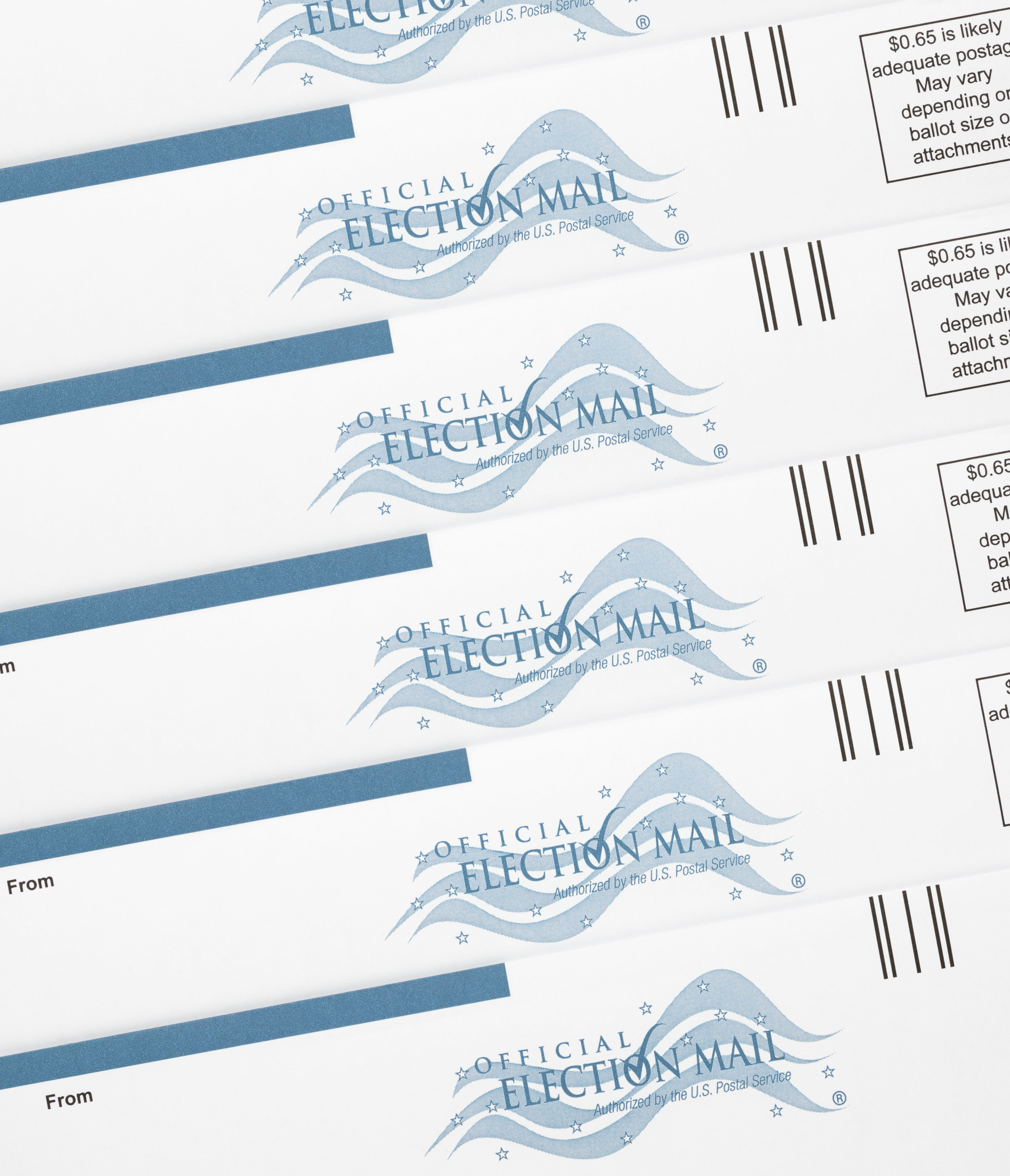 Colorado Springs, Colorado, USA - September 21, 2012: Several official US mail-in ballot envelopes showing the 'Official Election Mail' stamp. Mail-in ballots enable a person to vote through the mail instead of in person at a polling place.