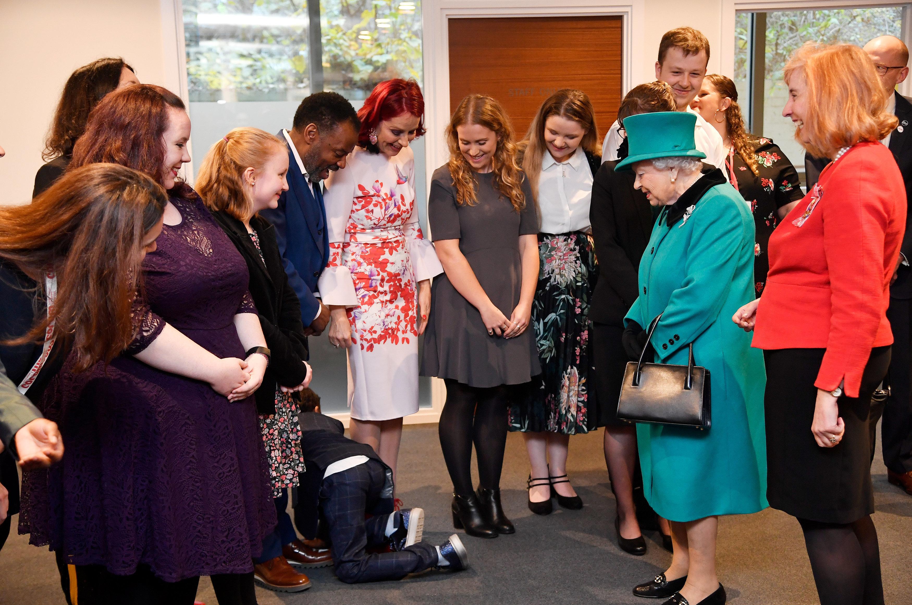 Queen Elizabeth II arrives to begin the Queen Elizabeth II Centre at Coram on December 05, 2018 in London, England.