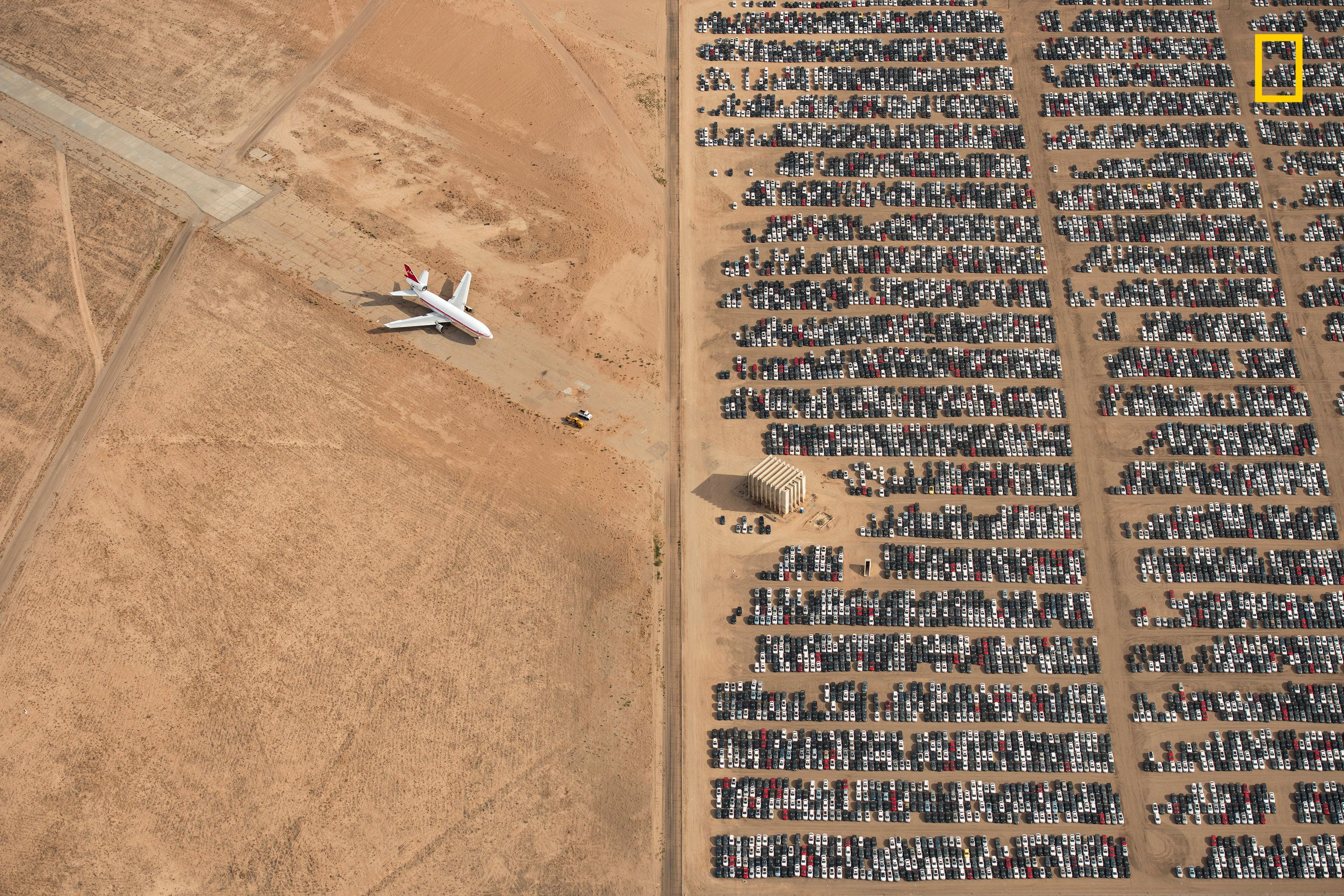 Grand Prize Winner - Thousands of Volkswagen and Audi cars sit idle in the middle of California's Mojave Desert. Models manufactured from 2009 to 2015 were designed to cheat emissions tests mandated by the U.S. Environmental Protection Agency. Following the scandal, Volkswagen recalled millions of cars. By capturing scenes like this one, I hope we will all become more conscious of and more caring toward our beautiful planet.