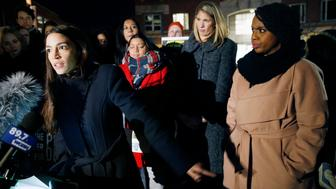 Rep.-elect Alexandria Ocasio-Cortez, D-N.Y.,, left, speaks at a small rally outside an orientation meeting for incoming members of Congress at Harvard University as Rep.-elect Ayanna Pressley, D-Mass., right, and Rep.-elect Lori Trahan, D-Mass., second from right, look on in Cambridge, Mass., Tuesday, Dec. 4, 2018. (AP Photo/Michael Dwyer)