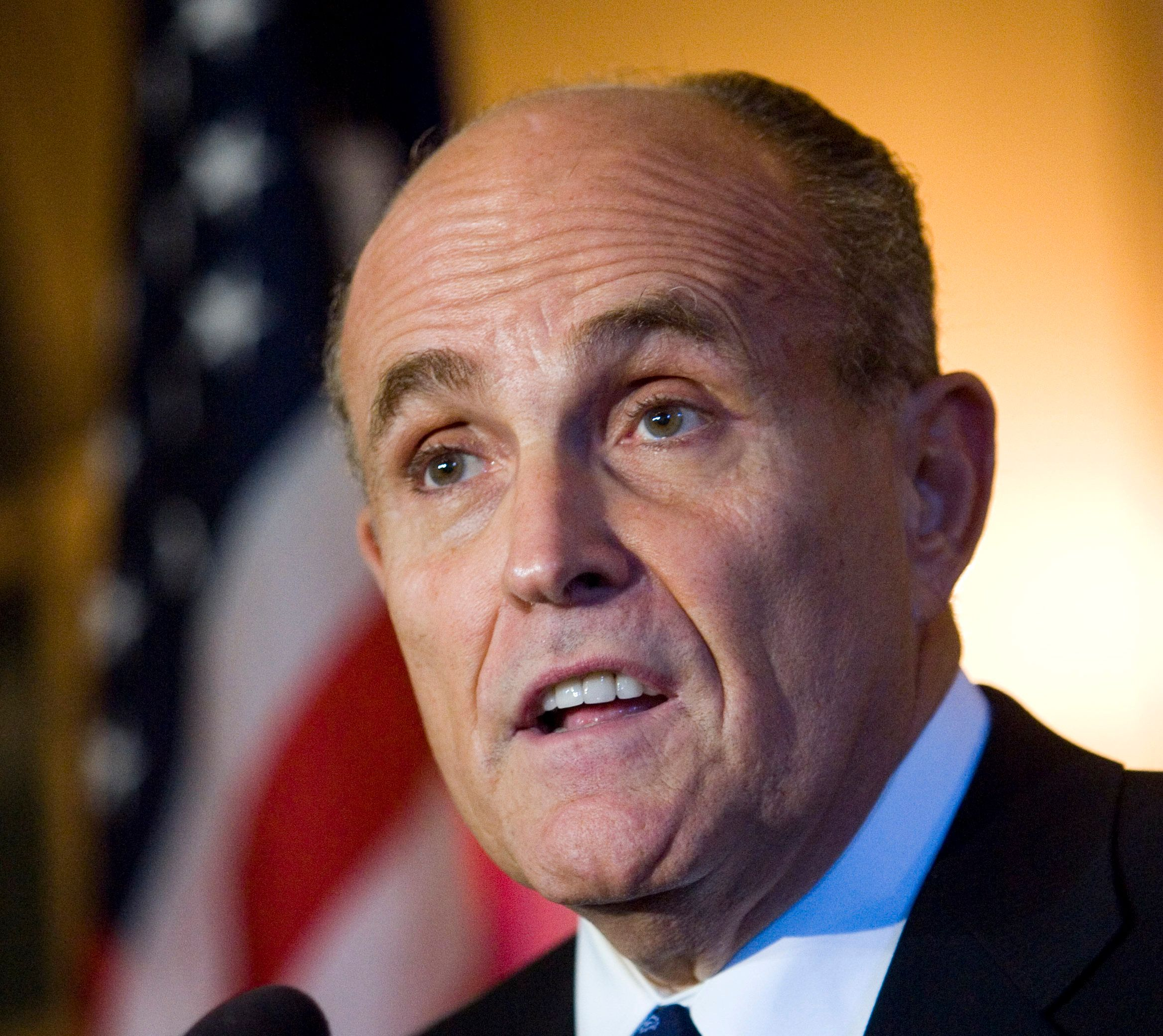"""FILE - In this Oct. 18, 2007 file photo, Rudy Giuliani answers questions following a fundraiser in Milwaukee. Giuliani is giving Hillary Clinton credit for her work on behalf of victims of the Sept. 11, 2001, terrorist attacks. Giuliani was asked at a Republican Party briefing Thursday, July 28, 2016, in Philadelphia whether he took issue with the Democratic convention speakers who'd been praising Clinton. Giuliani said she was """"enormously supportive and helpful."""" Clinton was a U.S. senator from New York at the time. (AP Photo/Morry Gash, File)"""