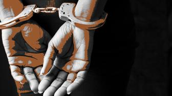 Black woman in handcuffs