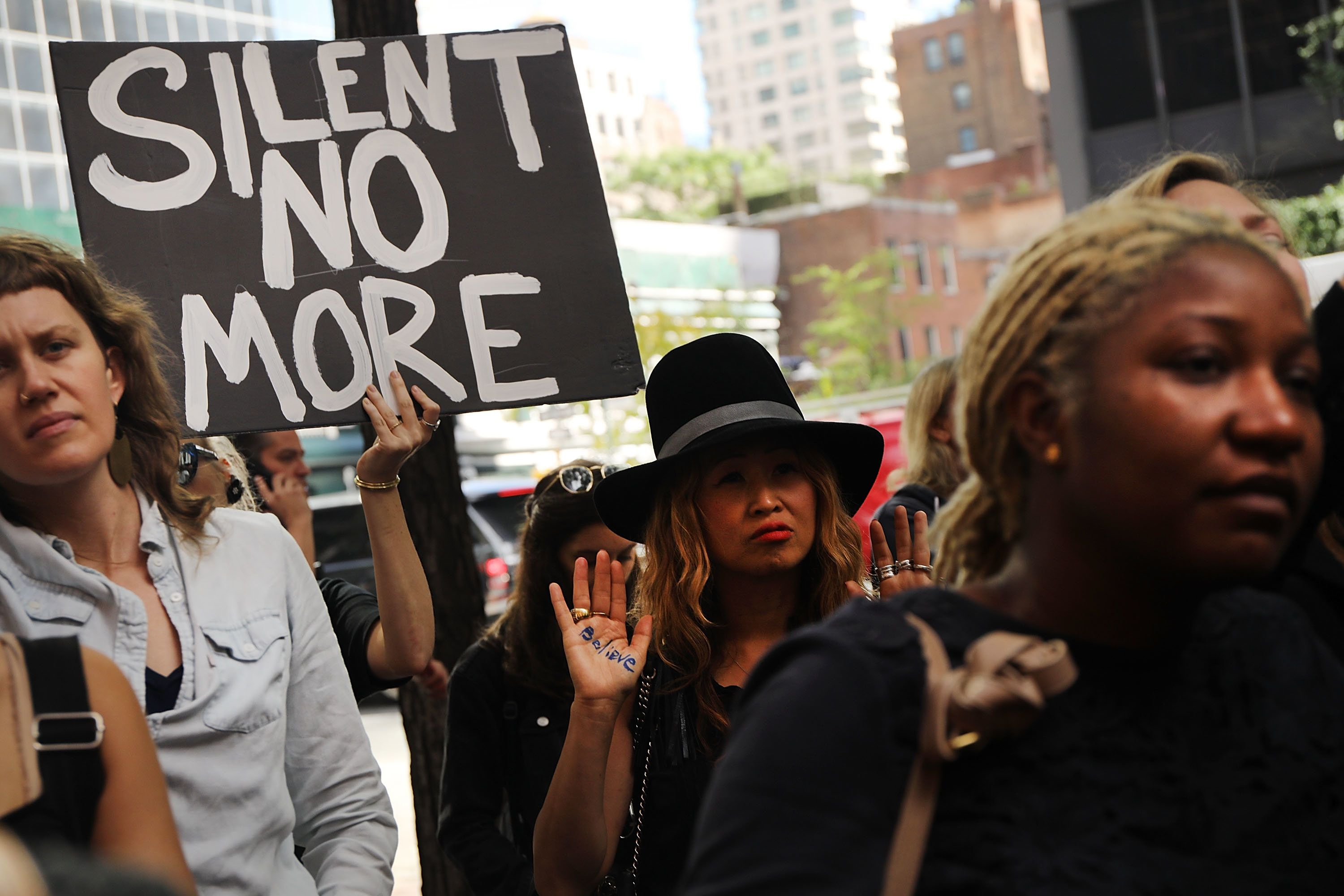 Dozens of protesters against the confirmation of Supreme Court nominee Brett Kavanaugh gather outside the New York office of Democratic Sen. Chuck Schumer on the afternoon that Christine Blasey Ford testified about her allegations of sexual assault against Kavanaugh on Sept. 27, 2018.